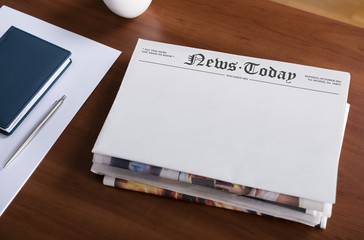 Blank newspapers on the office desktop