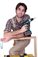 Man with hand drill