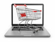 E-commerce. Shopping cart on laptop.