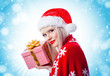 Pretty young blonde girl holding christmas gift