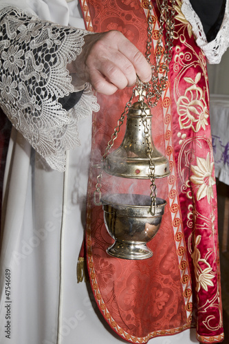 hand of catholic priest at incense