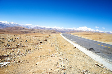 yellowish mountain road view in tibet