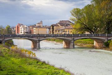 view of bridge through Parma stream, Italy