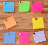 colorful sheets of paper on wooden board