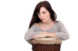 A woman playing the drum.