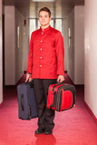Bellboy with Luggages in the Hallway