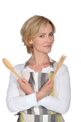 woman with wooden cutlery