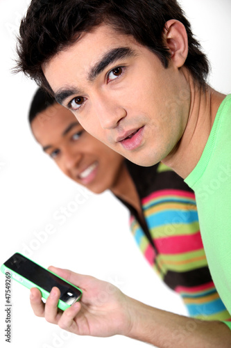 Young man with a funky cellphone
