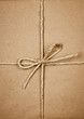 Package in brown paper tied with string