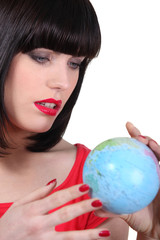 Woman searching on a globe