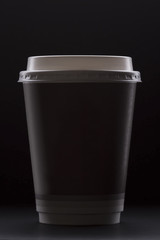 Paper coffee cup on a black background