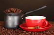 Coffee maker with red cup on wooden table