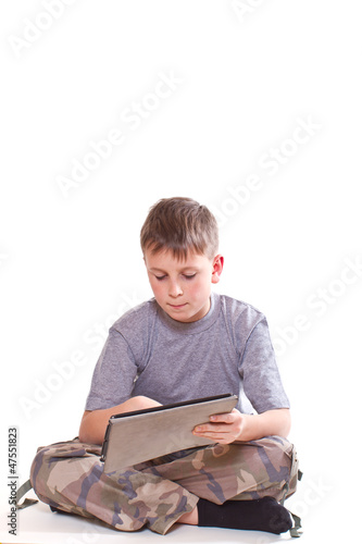 Teen plays on the tablet computer