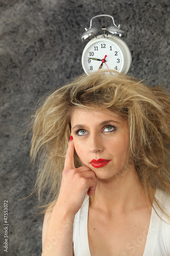 young woman with a clock on her head