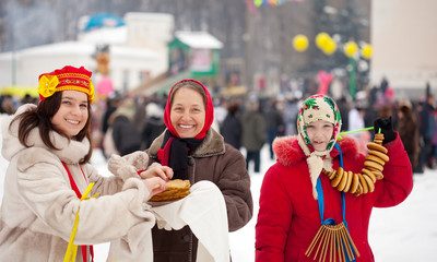 Women eating pancakes during  Shrovetide