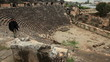Tourist man visiting ancient  amphitheater
