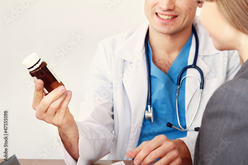 Male doctor and young woman patient