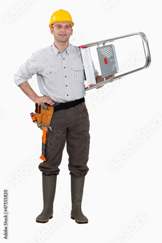 Tradesman carrying a stepladder