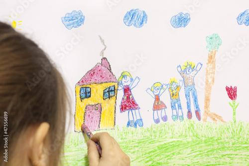 Girl draws her own house and happy family
