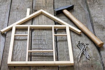 Wooden house construction renovation abstract concept