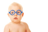 Baby in glasses looking at something