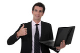 Businessman holding laptop