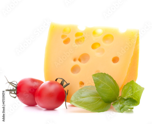 Cheese and basil leaves still life