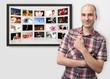 man pointing finger on digital photo album