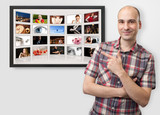 man pointing finger on digital photo album