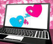 Two Hearts On Laptop Shows Love And Commitment