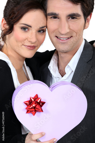 Romantic couple with heart-shaped box