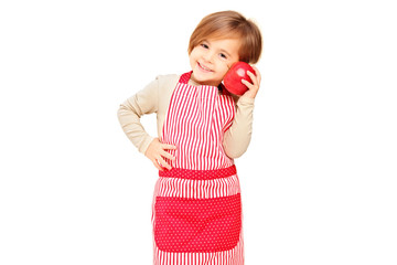 A smiling girl with apron holding a red apple