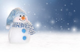 Fototapety Winter background with a snowman, snow and snowflakes