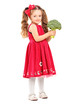 Full length portrait of a smiling girl holding a broccoli