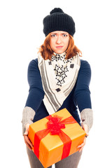 Disappointed woman with gift box