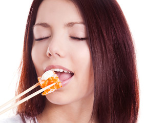 woman eating sushi