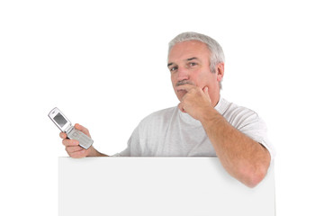 Expressive man with cellphone and white sign