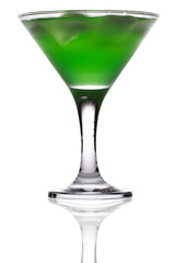 green martini cocktail into glass on white background