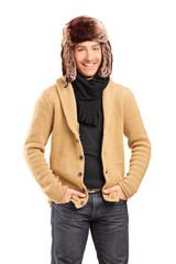 Handsome smiling man wearing fur hat