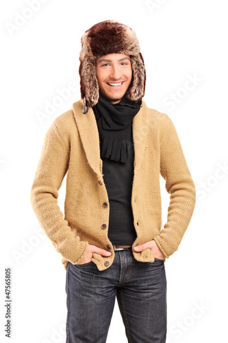 Handsome smiling man wearing fur hat