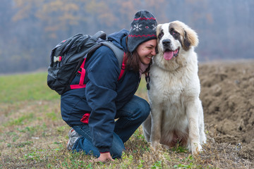 Young girl showing affection to her Bucovina shepherd dog