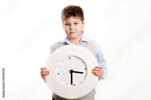 boy with a clock on a light background