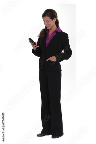 Businesswoman checking e-mails telephone