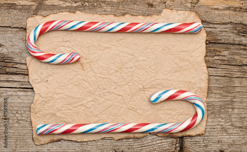 Colorful Candy cane on an old retro paper background
