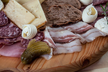 Traditional Italian cold cut on wood cutting board
