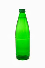 green glass bottle with mineral water