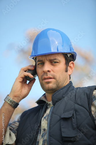 foreman in construction site making a call