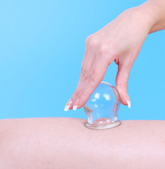 vacuum massage therapy over blue background, cupping