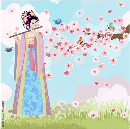 Foto op Canvas Bloemen vrouw Beautiful Oriental girl near cherry blossoms