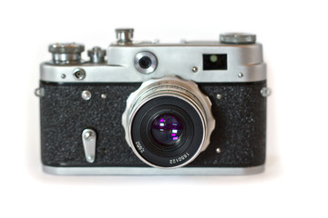 Front of an old film camera with lens